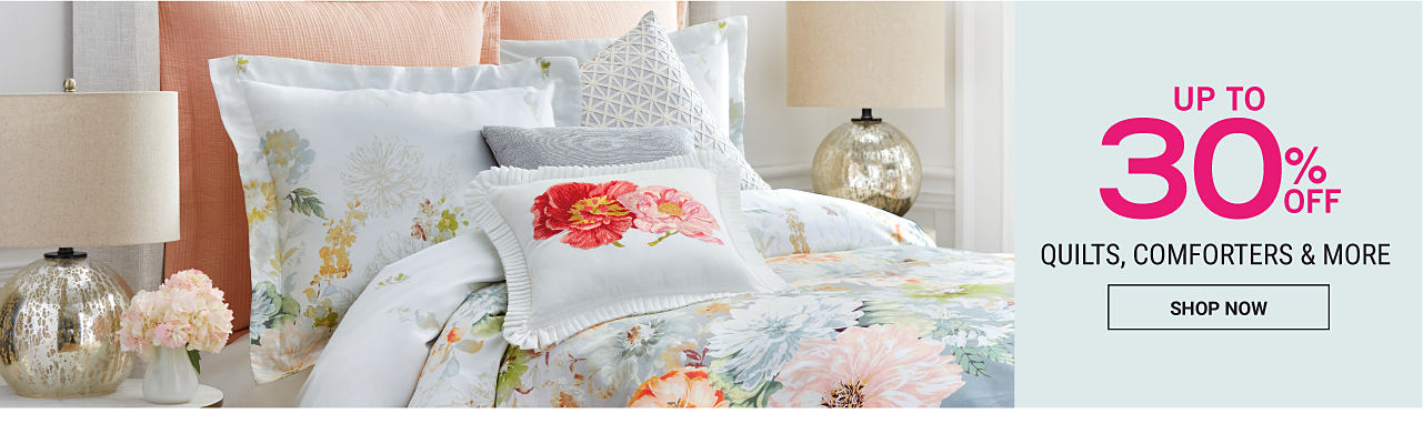 A bed made with a mult-colored floral print comforter & matching pillows. Up to 30% off quilts, comforters & more. Shop now.