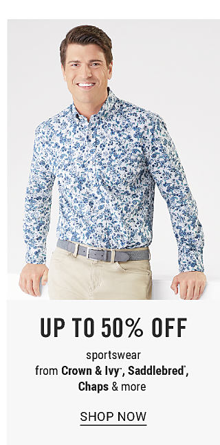 A man wearing a blue & white paisley print long sleeved button front shirt & beige pants. Up to 50% off sportswear from Crown & Ivy, Saddlebred, Chaps & more. Shop now.