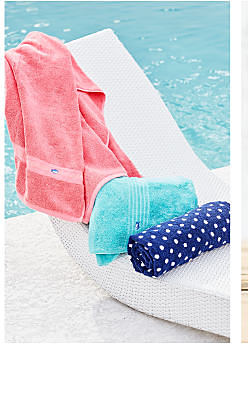 An assortment of beach towels in a variety of colors & patterns. Shop beach towels.