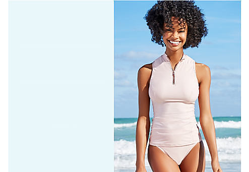 A woman wearing a light pink one piece swimsuit. Bust Support. Give yourself a lift. Shop now.