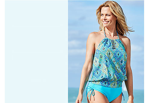 A woman wearing a teal & green print swim top & teal swim bottoms. Hip Minimizer. Innovative technology for a smooth silhouette. Shop now.