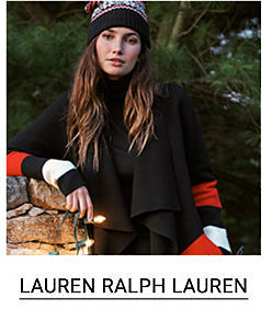 A young woman in a black cardigan with red, white and black sleeves and a winter beanie hat. Shop Lauren Ralph Lauren.