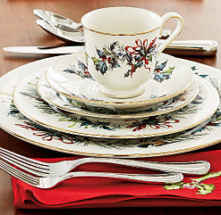A dining table set with holiday-themed plates, drinkware & decor. Shop Christmas dinnerware.