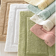 An assortment of bath rugs in a variety of colors. Shop bath rugs.