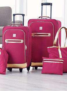 A 5-piece fuchsia luggage set. Shop luggage.
