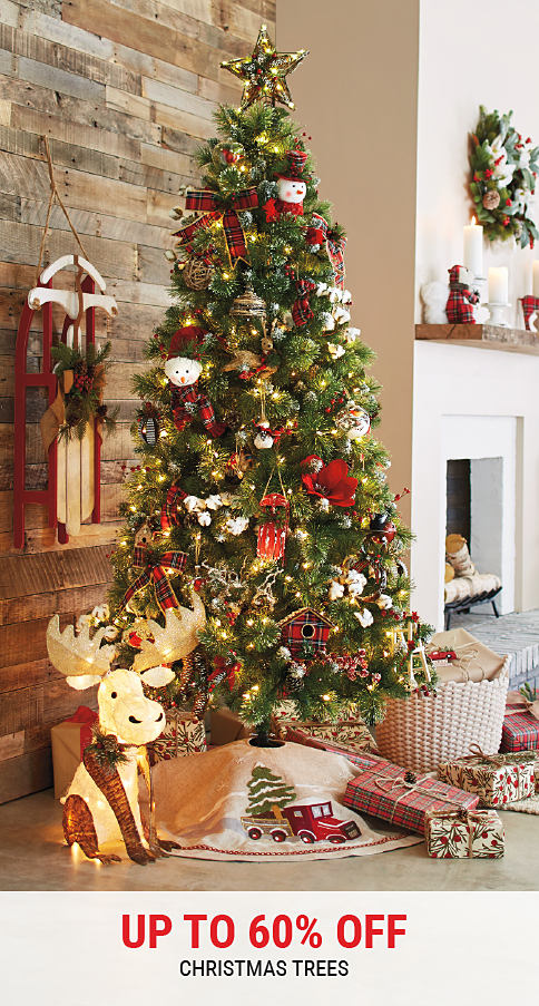 A Christmas tree decorated with ornaments. Up to 60% off Christmas trees. Shop now.