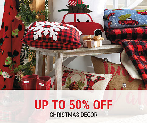 An assortment of holiday-themed decor. Up to 50% off Christmas decor. Shop now.