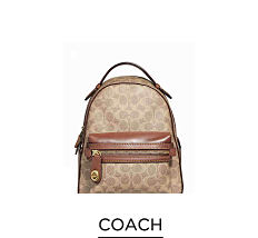A beige & brown leather backpack purse. Shop Coach.