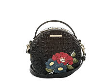 A black crossbody handbag with multi colored floral side detail. Shop crossbody.