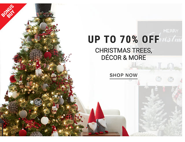 Bonus Buy. A Christmas tree decorated with lights and ornaments. Two little red gnomes sit on a table in a room decorated for Christmas. Up to 70% off Christmas trees, decor and more. Shop now.