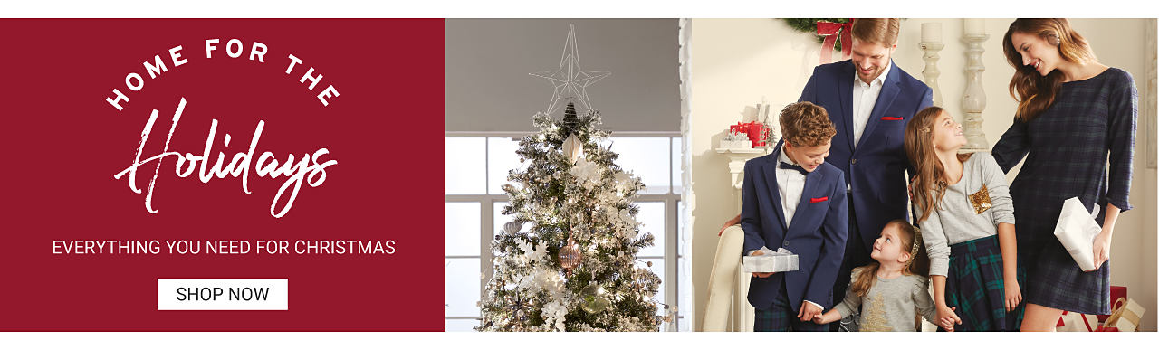 Home for the holidays. Everything you need for Christmas. Shop now. A family is dressed in their Christmas best, standing in a room decorated for the holidays.