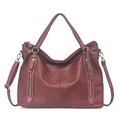 A burgundy leather handbag. Shop handbags.
