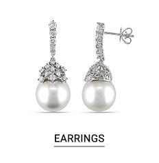 A pair of pearl earrings. Shop earrings.