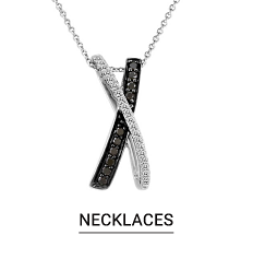 A silver necklace lined with small diamonds. Shop necklaces.