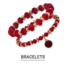 A gold and red charm bracelet. Shop bracelets.