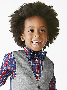 A toddler boy wearing a red, blue & white plaid button-front shirt, a navy & white polka dot bow tie & a gray vest. Shop toddler boys.