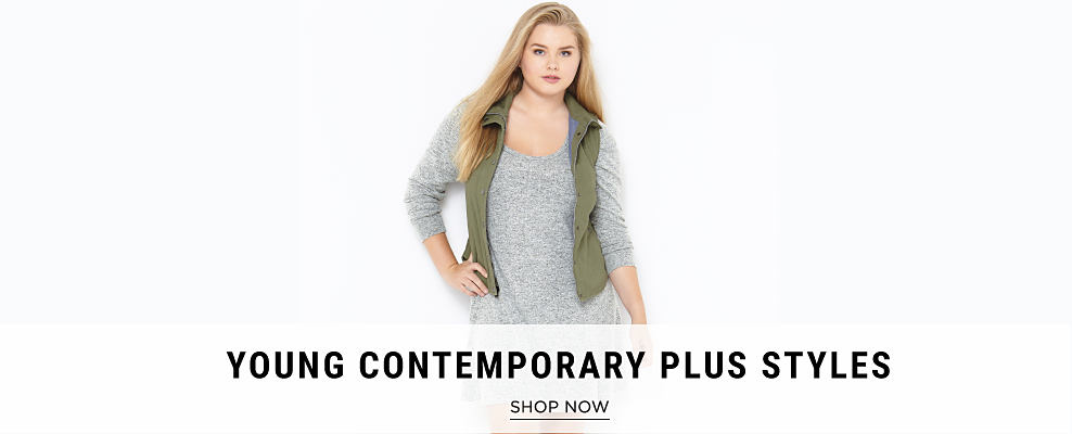 A young woman wearing an olive green fleece vest & a gray sweater dress. Young Contemporary Plus Styles. Shop now.
