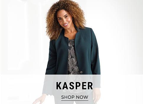 A woman wearing a navy jacket & a navy & white print top. Kasper. Shop now.