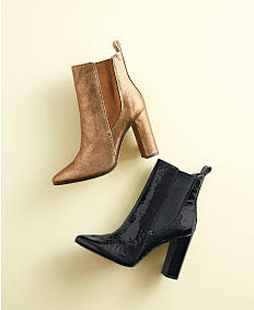 A brown leather women's boot & a black leather women's boot. Shop shoes.
