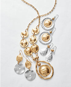 An assortment of earrings & a necklace. Shop jewelry.