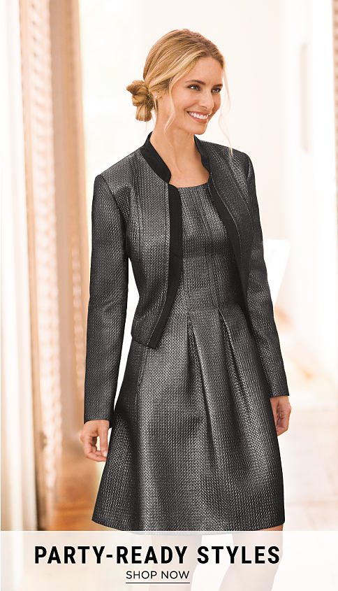 A woman wearing a wearing a gray dress & a grey waistcoat with black trim. Party-Ready Styles. Shop now.