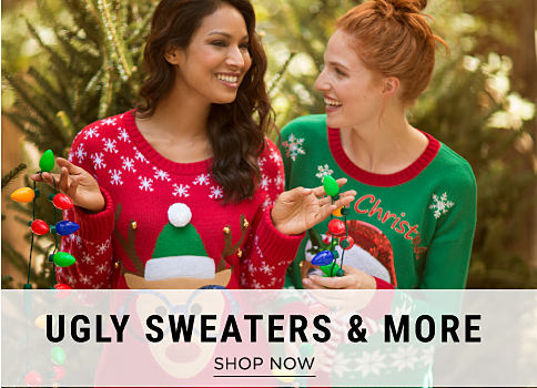2 women wearing holiday-themed sweaters. Ugly Sweaters & More. Shop now.