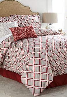 A bed made with a gray, red & white patterned comforter with matching pillows. Shop bed in a bag.