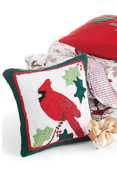 An assortment of holiday-themed throw pillows. Shop throw pillows.