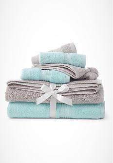 A stack of folded gray & teal washcloths & bath towels. Shop bath towels.