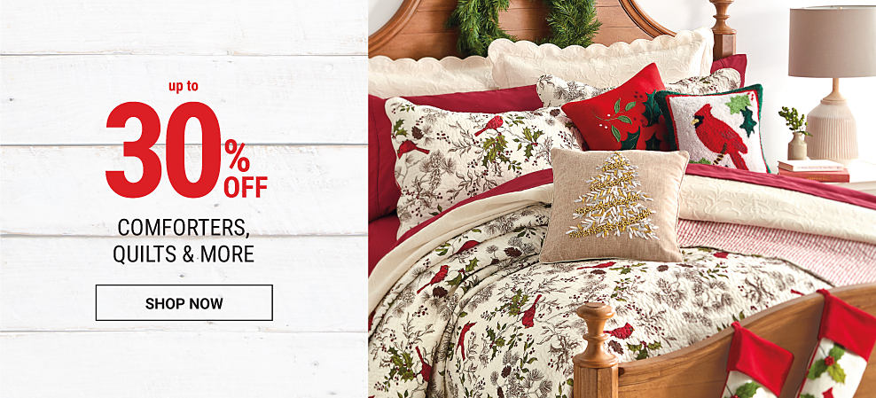 A bed made with a holiday-themed comforter, matching pillows & red sheets. Up to 30% off comforters, quilts & more. Shop now.