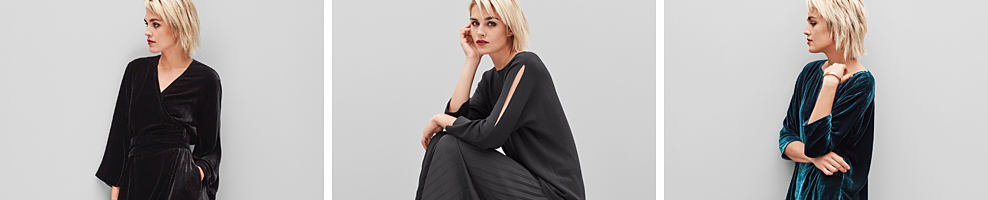 A woman wearing a black top & gray pants. Eileen Fisher. Simple shapes that let the quality of the materials shine. A designer known for leading the way toward sustainable fashion.