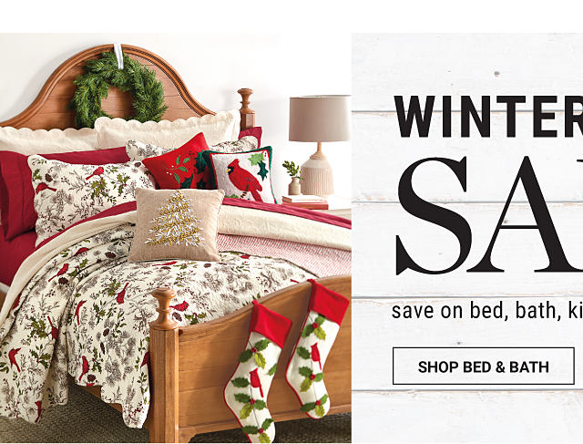 A bed made with a holiday-themed comforter, matching pillows & red sheets. Winter Home Sale. Save on bed, bath, kitchen, decor & more. Shop bed & bath.