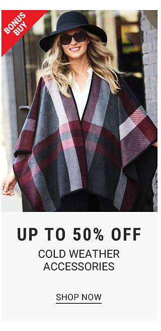 A woman in a plaid poncho, hat and sunglasses. Bonus buy. Up to 50% off cold weather accessories. Shop now.