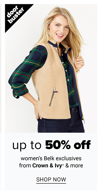 A woman wearing a beige fleece vest over a green, blue & yellow plaid flannel blouse & black jeans. Doorbuster. Up to 50% off women's Belk exclusives from Crown & Ivy & more. Shop now.