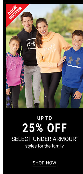 A girl wearing a light purple long sleeved top & gray pants standing next to a man wearing a black & white Under Armour logo hoodies & gray pants, a woman weaing a yellow cowl neck sweater & black pants & a boy wearing a blue & gray Under Armour logo hoodie. Doorbuster. Up to 25% off select Under Armour styles for the family. Shop now.