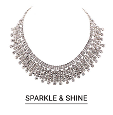 A silver tone multi tiered necklace. Shop holiday glam jewelry