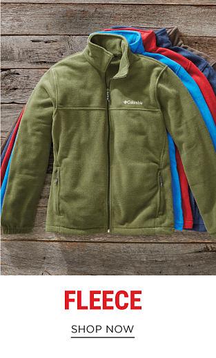 An assortment of zip-front fleece jackets in a variety of colors. Shop fleece.