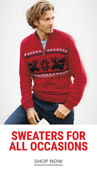 A man wearing a red, black & white holiday sweater & b;ue jeans. Sweaters for All Occasions. Shop now.