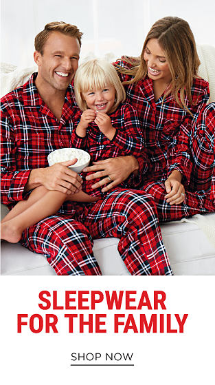 A man, woman & girl wearing matching red, blue & white flannel pajamas. Sleepwear for the Family. Shop now.