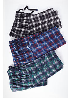 An assortment of men's plaid sleep pants. Shop sleepwear.
