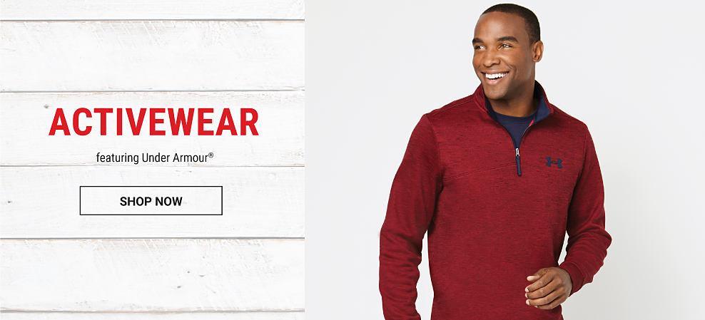 A man wearing a red quarter zip fleece & a black T-shirt. Activewear featuring Under Armour. Shop now.