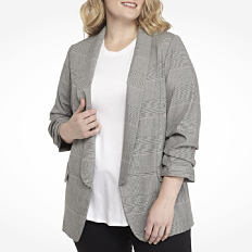 A woman wearing a gray blazer over a white top & black pants. Shop jackets & blazers