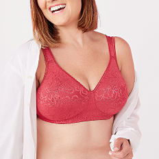 A woman wearing a red bra. Shop intimates.