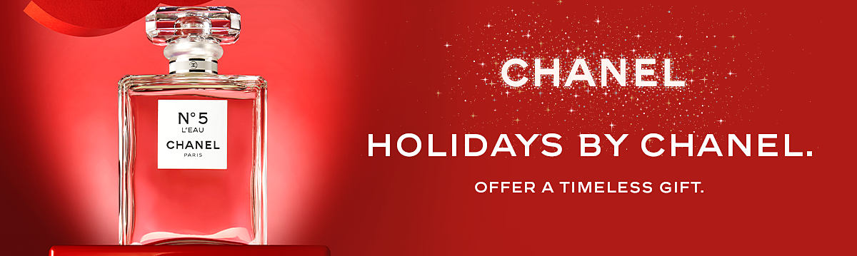 A bottle of Chanel Number 5 perfume. Chanel Holidays by Chanel. Offer a timeless gift.