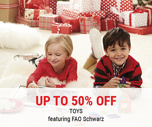 A girl & a boy surrounded by presents, playing with toys. Up to 50% off toys featuring FAO Schwarz. Shop now.