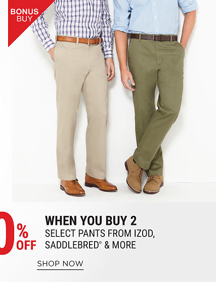 A man wearing a red, blue & white plaid button-front shirt, beige pants & brown leather shoes standing next to a man wearing a light blue button-front shirt, olive green pants & brown leather shoes. Bonus Buy. 60% off when you buy 2 select pants from Izod, Saddlebred & more. Shop now.