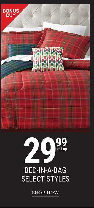 A bed made with a red, green & yellow plaid comforter & matching pillows. Bonus Buy. 29.99 & up bed in a bag select styles. Shop now.