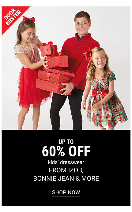 A girl wearing a white & red short sleeved top & a red skirt standing next to a boy wearing a red quarter zip fleece over a button front shirt & blue jeans & a girl wearing a red, green & white plaid short sleeved dress. DoorBuster. Up to 60% off kids dresswear from Izod, Bonnie Jean & more. Shop now.