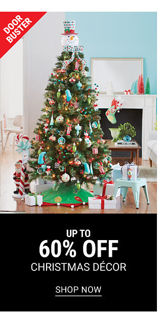 A fully decorated Christmas tree surrounded by wrapped presents. DoorBuster. Up to 60% off Christmas decor. Shop now.