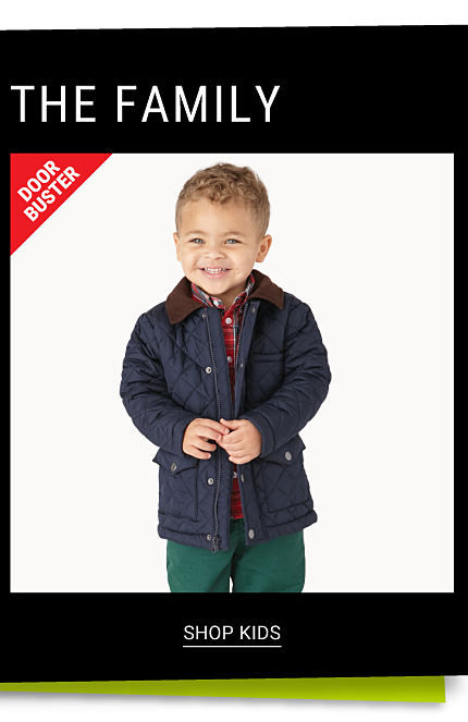 Up to 60% off Outerwear for the Family. A boy wearing a navy coat over a red & black plaid button front shirt & green pants. DoorBuster. Shop kids.
